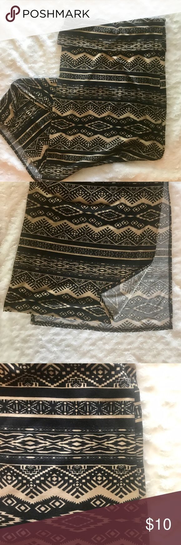 Tribal maxi skirt Black and nude tribal print maxi skirt with side slots. Stretchy and super comfy. Form fitting. In great condition. Stoosh Skirts Maxi