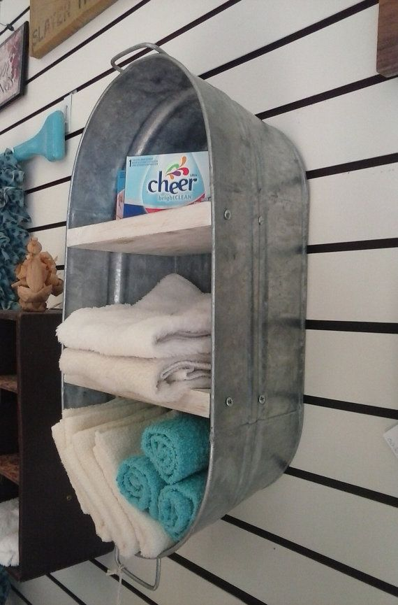 This is Wash Tub that we re-purposed into a hanging wall shelf/cupboard. Perfect for the bath, laundry room or Kitchen. Great for holding towels. Measures Approx.: 19 H x 6 L x 10-1/4 W Shelf Distance: Bottom to Middle shelf 6 H, Middle to Top shelf 5-1/2 H, Top shelf to the Top of the Bucket 6 H