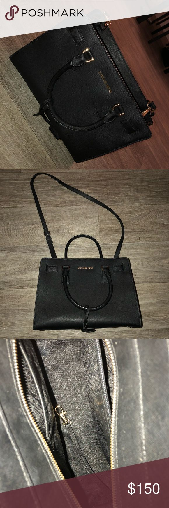 Black authentic Michael Kors purse Used for a day before realizing I like the smaller crossbody size. Been in the closet since. Black and gold. Purchased from Macys June 2017. Michael Kors Bags Satchels
