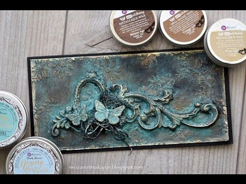 A mixedmedia card made with products from Prima Marketing. I have used molds made with paperclay. Black gesso, 3d gloss gel Artisan Powder Art Alchemy waxes....