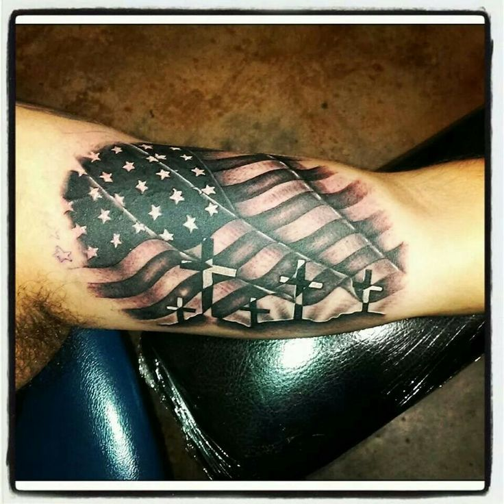 American flag with crosses This is a pretty cool looking American flag tattoo with crosses.