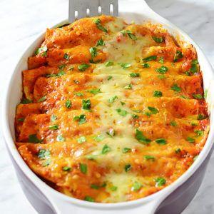 Enchiladas Suizas (Swiss-style Enchiladas) - extra cheesy chicken enchiladas in red enchilada sauce (rojas).