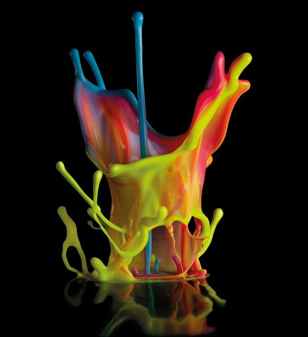 These stunning images show vibrant splashes of paint 'dancing' to sound vibrations.  Photographers created the series of rainbow paint sculp...