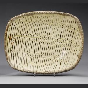 A Staffordshire slipware dish late 18th century