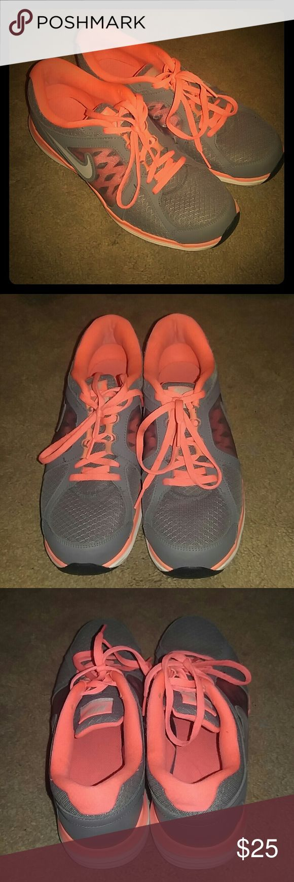 Nike Dual Fusion Athletic Shoes These are a re-Posh because they are the wrong size. Pristine condition. Like new! Neon coral/orange and grey in color. Nike Shoes Athletic Shoes
