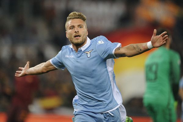 Ciro Immobile of SS lazio celebrates their second goal during the TIM Cup match between AS Roma and SS Lazio at Stadio Olimpico on April 4, 2017 in Rome, Italy.