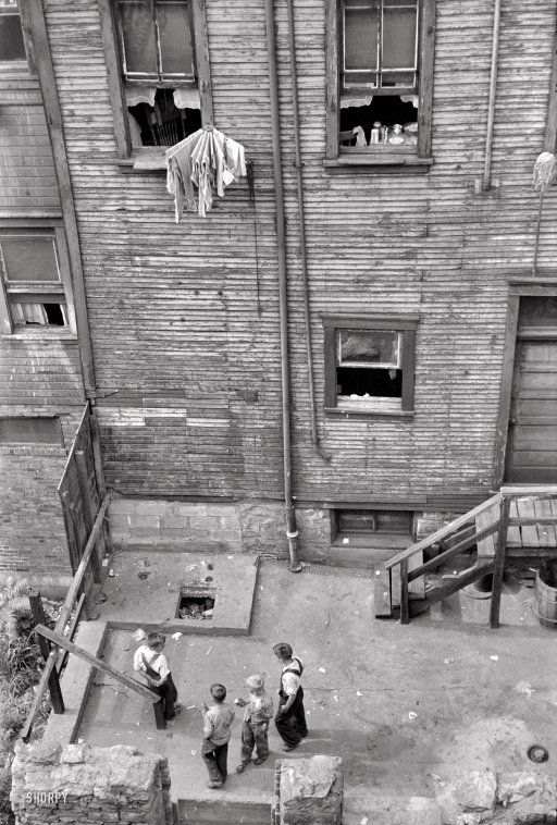 "July 1938. ""Slums in Pittsburgh, Pennsylvania."""