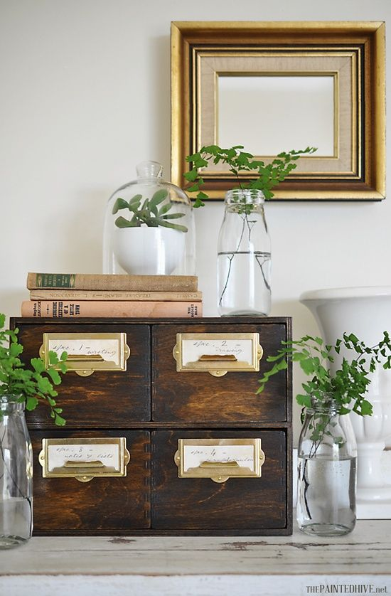 Card File Drawers, these are from IKEA and have been antiqued. This photo and the idea were featured in a magazine! Good for her!