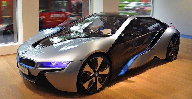 """i8 BMW - The i8 is a plug-in hybrid that's a """"sports car with the emission values and consumption of a compact car."""" The three cylinder engine will deliver 228 horsepower by itself, and you'll also find an electric motor with two transmission. The combo delivers 357 horsepower."""