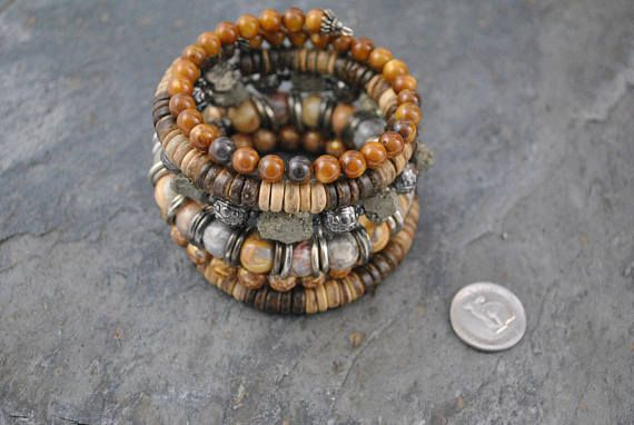 Tribal Style Crazy Lace Agate & Pyrite 6 Strand Memory Wire Cuff Bracelet #memorywire #six #sixstrand #tribal #tribalstyle #artisan #artisanbracelet #oneofakind #handmade #gemstone #shell #agate #crazylace #crazylaceagate #gunmetal #pewter #pyrite #roughpyrite #pryritechunks #heishi #coconut #coconutheishi #natural #neutral #showy #unique #statement #warm #warmtones