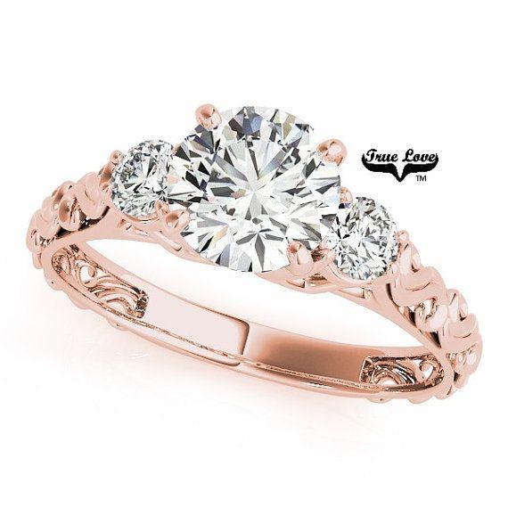 Moissanite Engagement Ring14 kt. Rose Gold Center by TrekJewellers