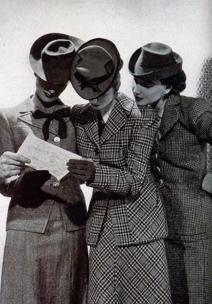 Women reading a map in 1940s Skirt Suits.