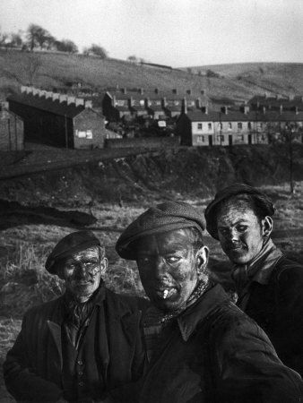 Three Welsh coal miners just up from the pits after a day's work in coal mine in Wales, photo by W. Eugene Smith