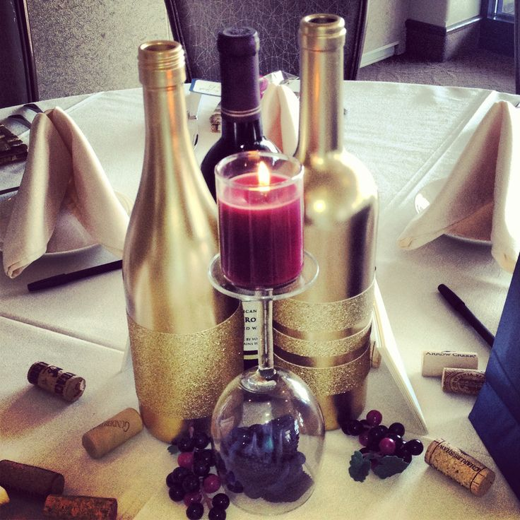 Wine bottles, Centerpieces and Votive candles
