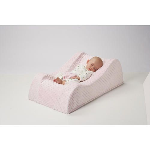 "Nap Nanny Chill Portable Recliner - Minky Pink - Nap Nanny - Babies ""R"" Us   I am seriously considering getting one of these. All my kiddos have needed to sleep up right so it looks like a good solution instead of trying to prop them this baby with pillows or blankets."