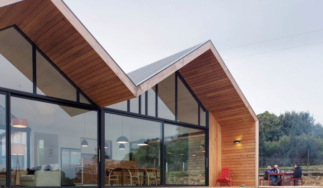 Love the timber clad overhanging roof eaves