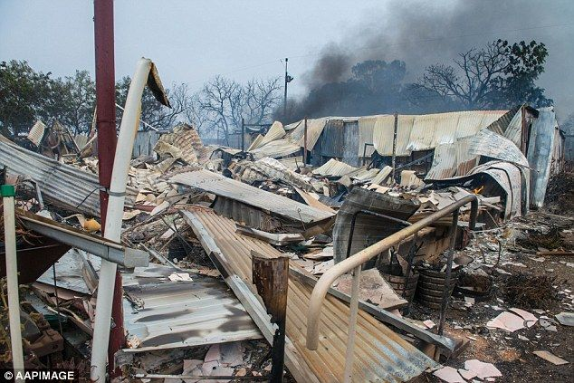 At least 16 homes have been destroyed, as well as outbuildings, vehicles and farm machiner...