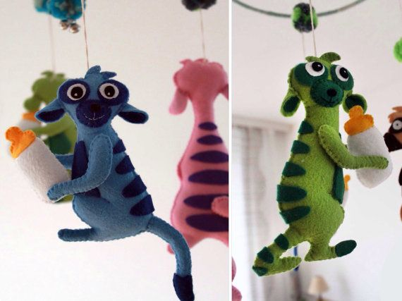 Nursery mobile with felt meerkats and wool balls. by Obyshandmade