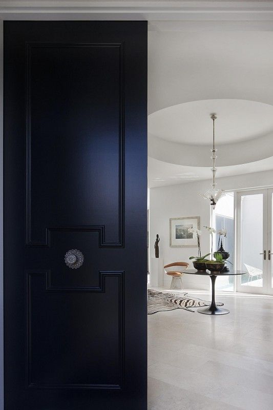 FOYERS & ENTRYWAYS: The Spaces Between  |  Classic modern furnishings mix with antiques in this Toorack, Australia residence designed by David Hicks.