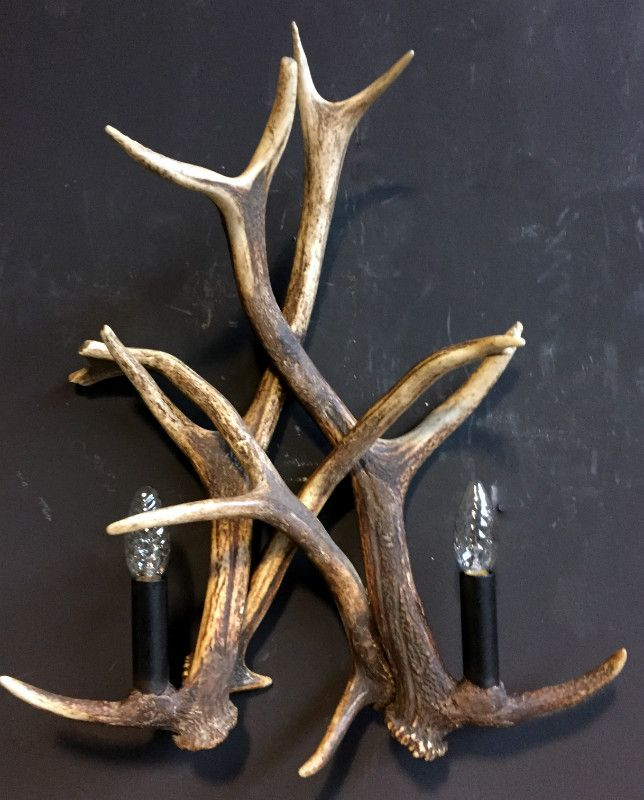 Wall lamp made of deer antlers. Lamps made of antlers, http://www.dejonginterieur.com/catalog/lamps-chandeliers/lamps-made-of-antlers