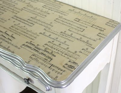 Mod Podge sheet music on desktop by @ShabbyCreek. Adorable!