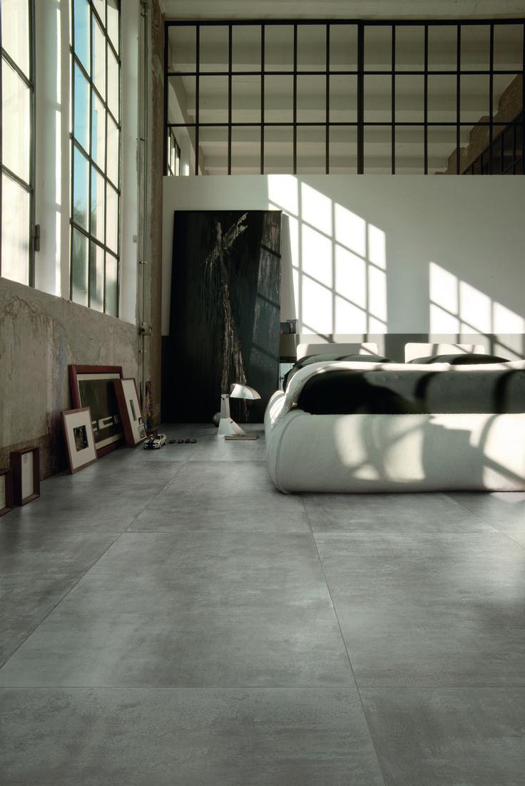Tegels in de slaapkamer: voor een minimalistische design badkamer kiest u bijvoorbeeld voor de grote stoere beton look vloertegels!