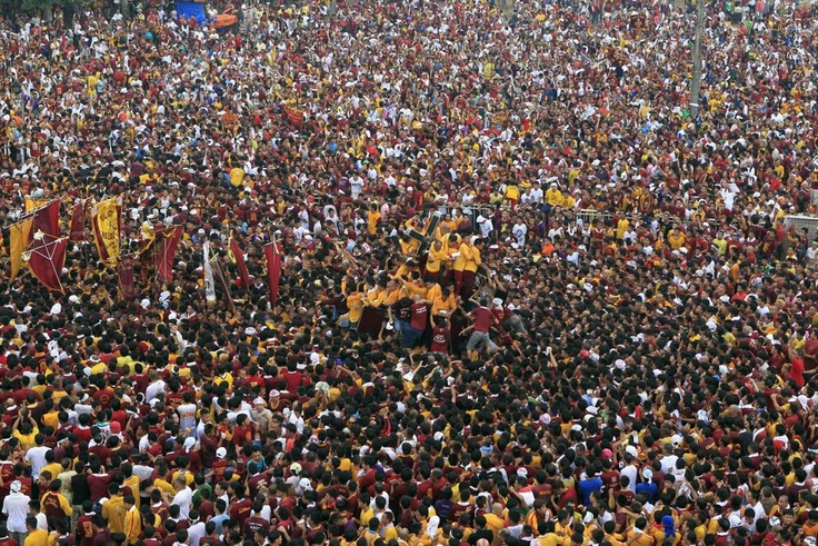 Filipinos flock the procession of the Black Nazarene