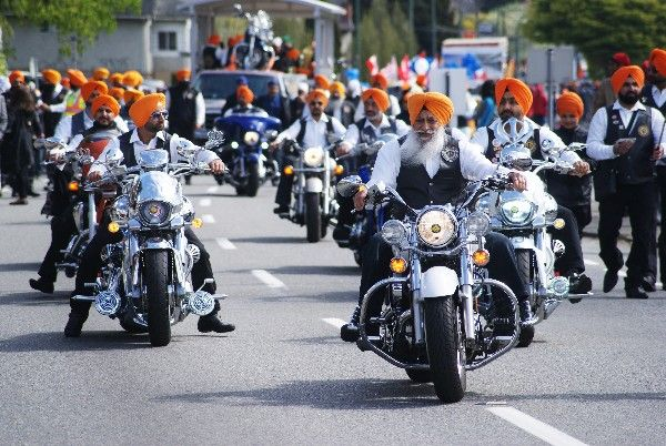 The parade itself at the Vancouver Vaisakhi festivities isn't a large one, but it moves slowly through the crowds, with frequent stops. Although fairly small, in total it takes close to five hours to complete.   Participants in the parade include trucks and trailers with music and dignitaries, lots of festive East Indian music, and this group of Sikh motorcyclists.   All along the parade route businesses and residents give out free food, including curry, bags of chips, ice cream and soft…