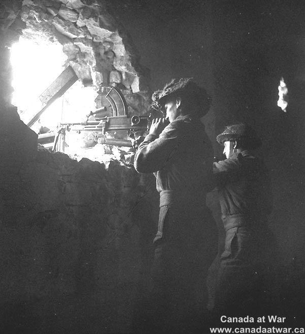 An unidentified infantryman of the Regina Rifles Regiment manning a Bren gun position in Vaucelles, 23  july 1944.