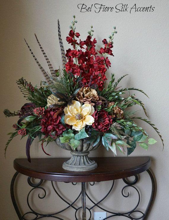17 best images about flower arrangements on pinterest for Dinner table floral arrangements