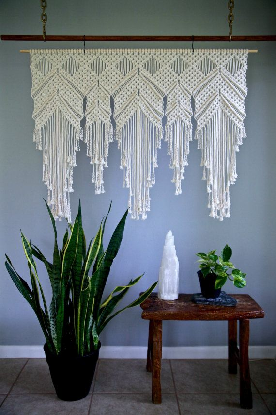 This extra large macrame wall hanging is made from 5mm natural white cotton rope and hangs from a wooden dowel. A unique piece that is sure to add texture and interest to any room! Would work especially well as a window valance or bedroom headboard! Would also make an amazing gift! Wooden dowel is 48 and measures approx. 36 long (4 x 3). You may choose for the wooden dowel to be stained a deep walnut color, or left natural as shown. Please note: the exact piece in the photos has sold. You...