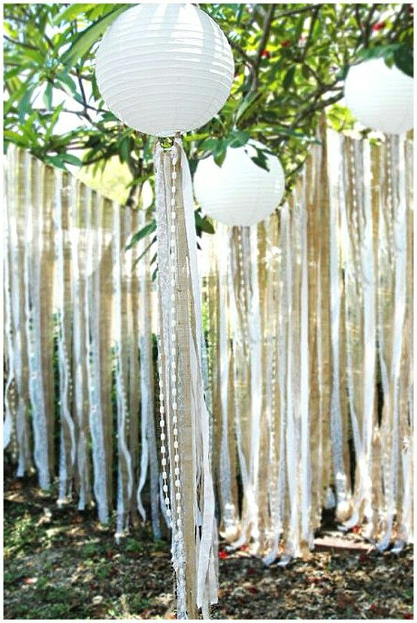 Ribbons, pearls hanging from lanterns.