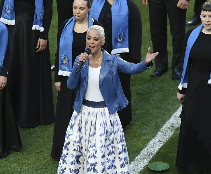 Fado singer Mariza singing in the opening of the Champions League final2014 in Lisbon, with a azulejo (portuguese tiles) pattern skirt.
