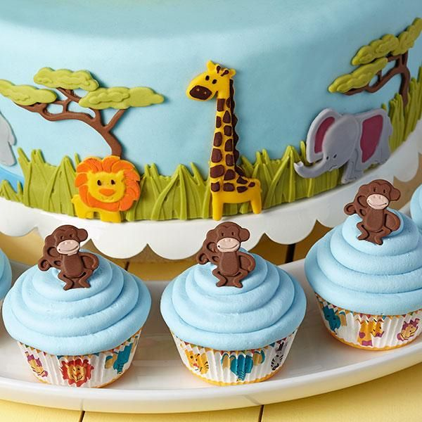 Jungle Animals Jamboree Fondant Cake  - Cute monkeys, elephants, giraffes and lions (oh, my!) parade across this wild landscape ready to celebrate! Create this incredible cake using Decorator Preferred Fondant along with the Wilton Jungle Animals Fondant and Gum Paste Mold.