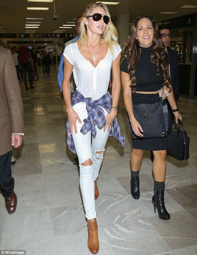 Off-duty: Candice touched down in Mexico yesterday sporting ripped white skinny jeans, a matching T-shirt and tan ankle boots