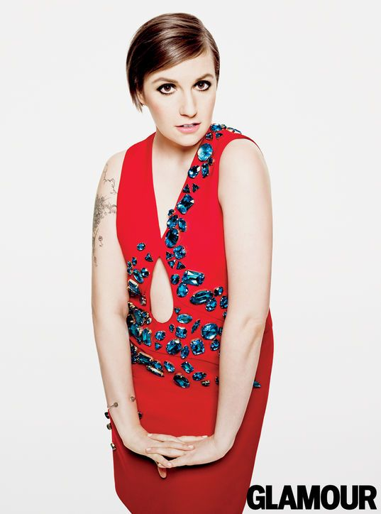 Lena Dunham in Glamour, April 2014. Dress, Prada; bangle, Georg Jensen, $235. Photo: Tom Munro