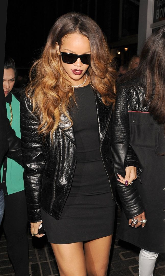 rihanna wearing a leather jacket, black short dress, rings