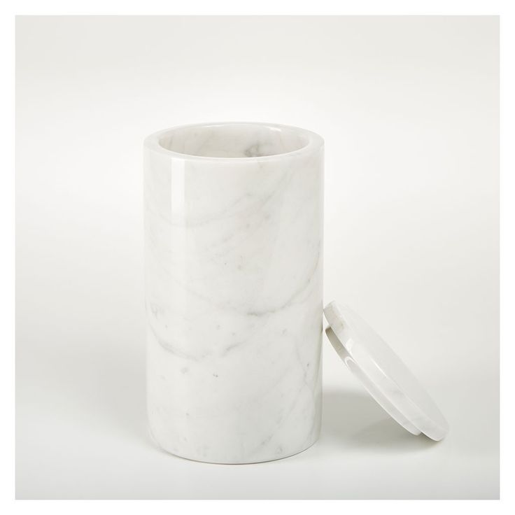 Add a luxurious accent to your kitchen with this heavyweight marble storage jar.