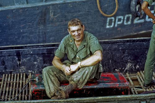 My Tho Navy Docks, Vietnam, 1969. A tired Major Hertwick after a day of frolicking in the mud of the Mekong Delta. He was a German national who became a U.S. citizen. He moved to the officer ranks from the non-com ranks and he truly was a maverick and sharp as a tack. Major Hertwick was the first U.S.Army officer in charge of Dinh Tuong Province's PHOENIX Program after its handoff to the U.S.Army by the C.I.A. in 1968. His muddy boots give hint to how his day was spent. Photo by Lance Nix