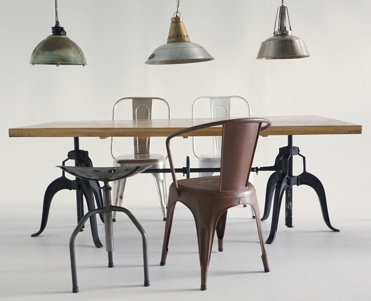 Sauvage Interiors industrial dining with selection of metal chairs and stool, and industrial pendant  trio #industrialpendant #industrialdining #pedestaldiningtable #parquetrytable