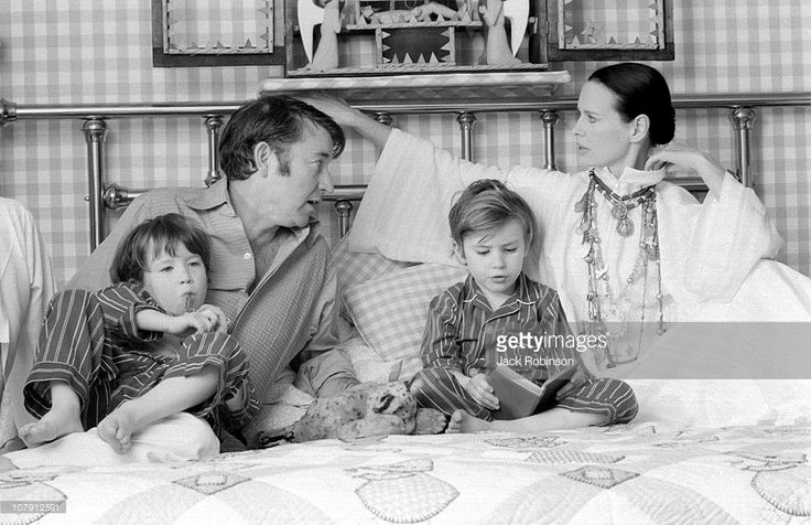 Actor and author Wyatt Emory Cooper, Carter Vanderbilt Cooper, Anderson Cooper, American heiress and socialite Gloria Vanderbilt pose for a family portrait as they play on a bed in their home on March 30, 1972 in Southampton, Long Island, New York.