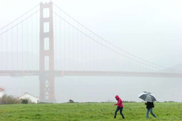 From right: Nathaniel Fleming and Emily Nahem take a stroll at Crissy Field during a storm on Monday, Feb. 20, 2017, in San Francisco, Calif. The National Weather Service announced flood, snow and wind advisories throughout the upper half of California. Photo: Santiago Mejia, The Chronicle
