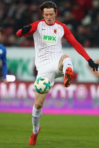 Michael Gregoritsch of Augsburg runs with the ball during the Bundesliga match between FC Augsburg and VfL Wolfsburg at WWK-Arena on November 25, 2017 in Augsburg, Germany.