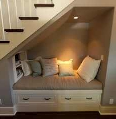 Cozy little nook underneath the stairs.