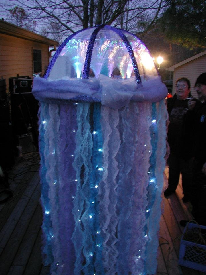 "This is a pic of Jelly fish costume I made last year! There were six color changing fiber optic lamps in the ""head""... And battery powered, blinking lights in some ""tendrils"".  It was a pain to make, but looked beautiful in the dark!"
