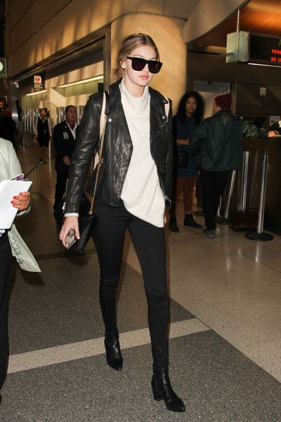 Gigi Hadid topped off her airport look with a black leather biker jacket by Nili Lotan.