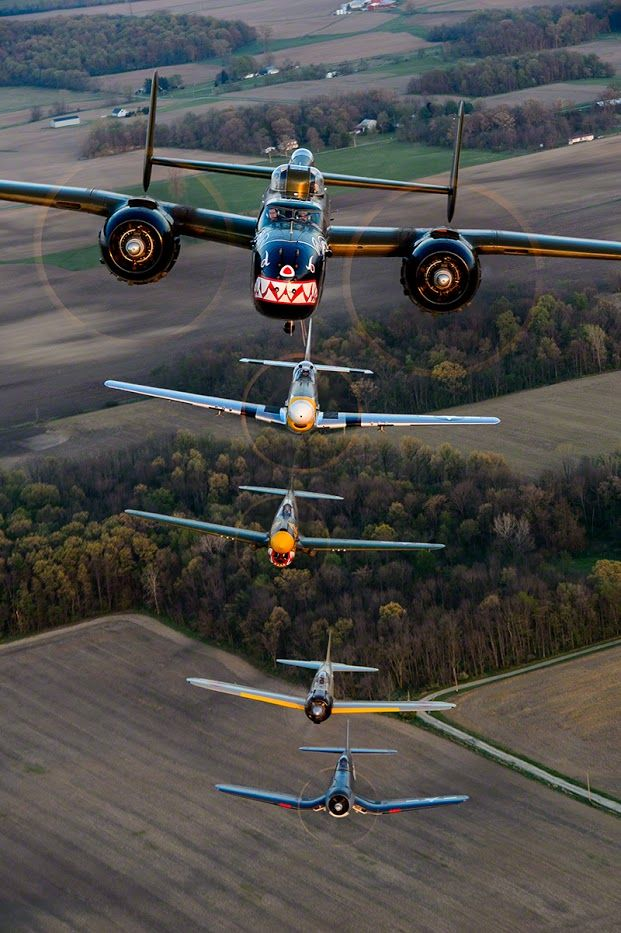 "Moose Peterson  Hangin with friends or in this case, flying and photographing them, I can think of almost nothing better. This is the Texas Flying Legends Museum doing what they do best. Shot a year ago April in OH, these amazingly talented pilots in these gorgeous aircraft pulled off an incredible formation in the setting sun. The machine guns in the tail of the B-25 ""Panchito"" were pulled out and I was inserted with my D4 / 70-200, flying lead in the formation."