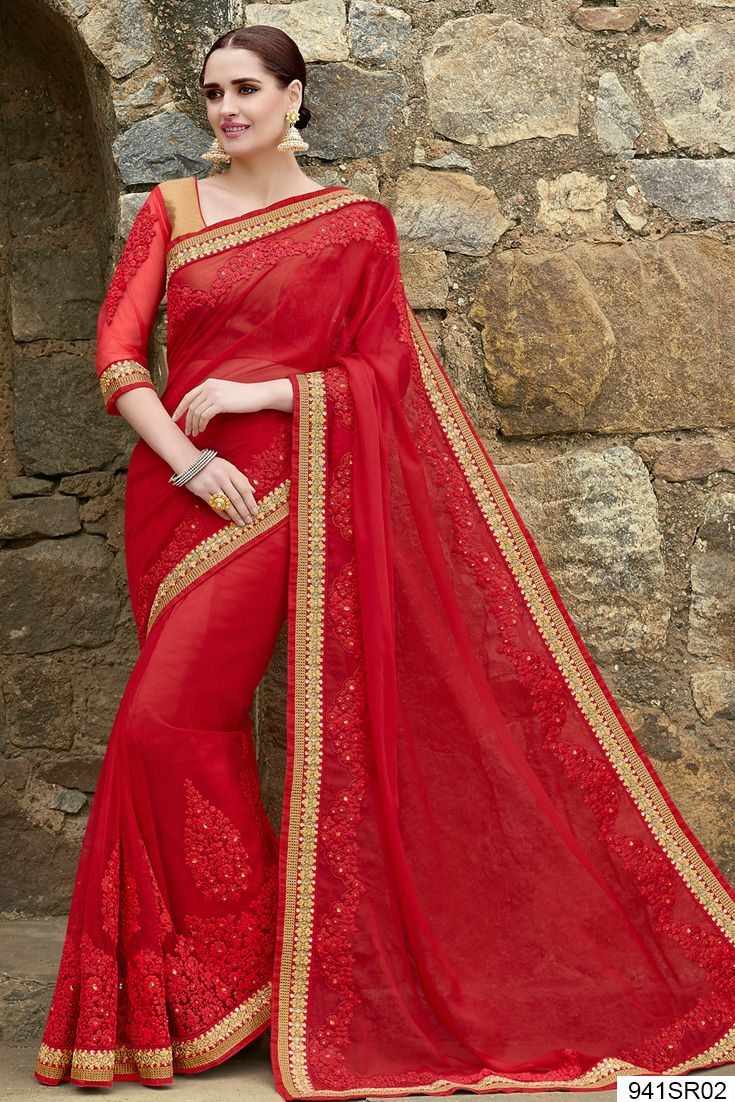 Red chiffon and net saree crafted with sequins, zari, resham embroidery, lace and patch border work. Available with beige brocade blouse with red net sleeves.Price US$ 121