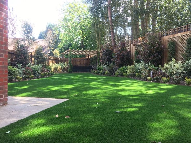 Trulawn Artificial Grass is incredibly realistic and fits in beautifully with established plants and shrubs. #ArtificialGrass #FakeGrass #GardenDesign #Gardening #GorgeousGarden