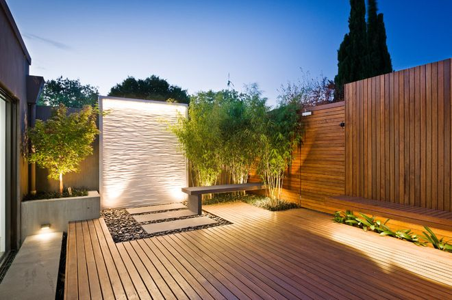 Contemporary Deck with amazing lighting and tile art wall - clean, crisp and modern.